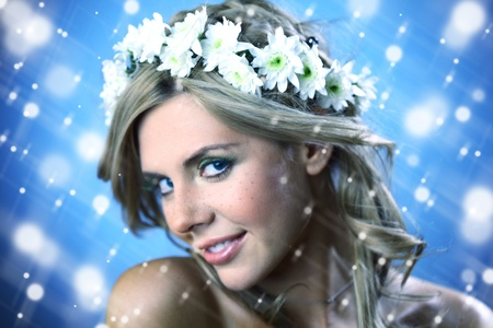 young women on blue flowers in hair photo