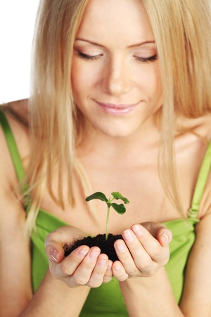 plant in blonde hands close up Stock Photo - 11373121