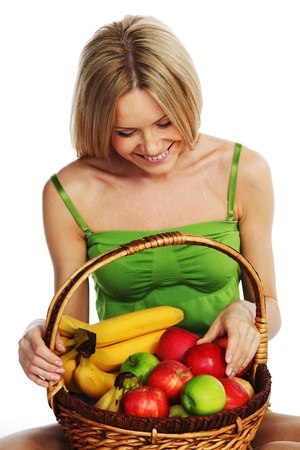 woman holds a basket of fruit on a white background photo