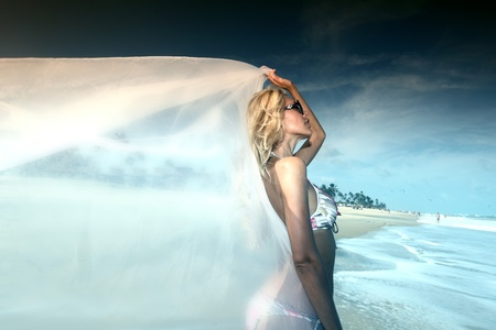 bride vacation on ocean coast photo