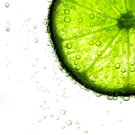 harsh light: lime slice in water bubbles
