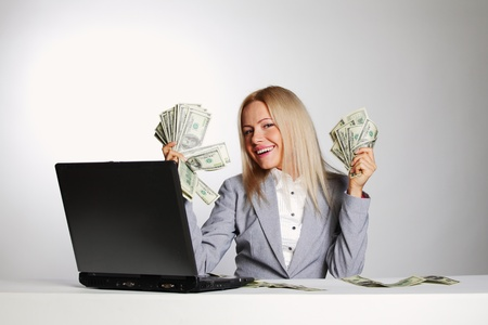 business woman working on laptop dollar in hands Stock Photo - 11393353