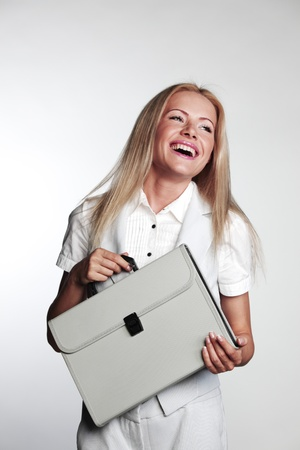 business woman with a briefcase on a gray background photo