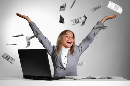 business woman drop dollars in the air  photo