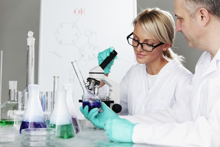 conducting: two scientist in chemical lab conducting experiments Stock Photo