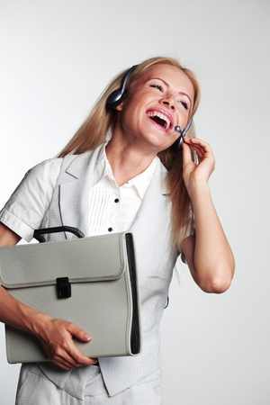 business woman in a headset on a gray background photo