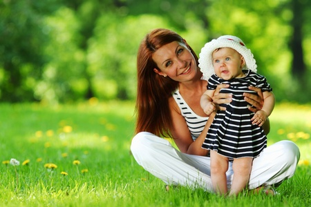 Happy mother and daughter on the green grass Stock Photo - 11949623