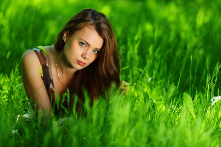 brunette lying on green grass Stock Photo - 11951289