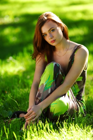 brunette sitting on green grass Stock Photo - 11951199