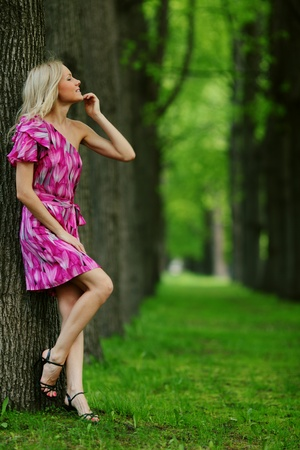 Woman stay on a shady park alley Stock Photo - 11951400