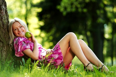 happy girl lying under a tree on a summer day photo