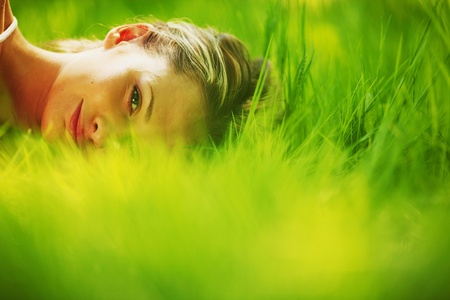 woman sleep on green grass photo