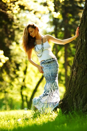girl standing next to a tree portrait Stock Photo - 11951435
