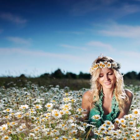 beautiful girl on the daisy flowers field