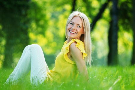 happy woman sitting on grass Stock Photo - 11951492