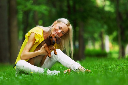 woman dachshund in her arms on grass Stock Photo - 11950834