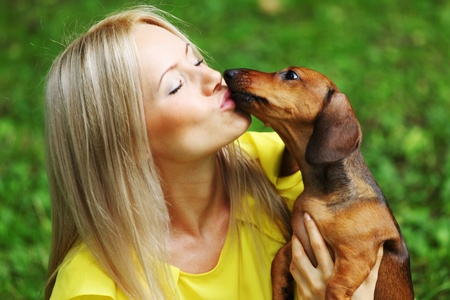 woman dachshund in her arms on grass Stock Photo - 11951460