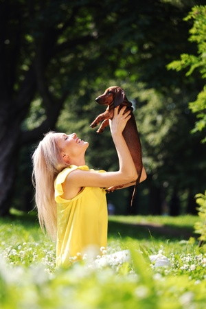 woman dachshund in her arms on grass Stock Photo - 11951175