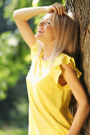 happy woman posing against a background of trees Stock Photo - 11951193