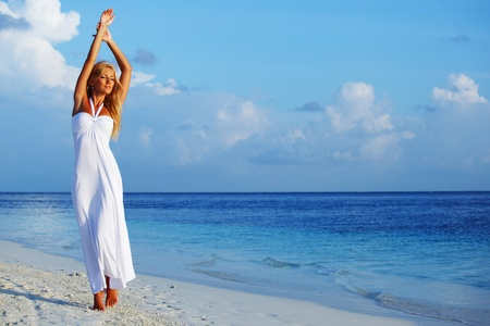 woman in a white dress on the ocean coast Stock Photo - 11975903