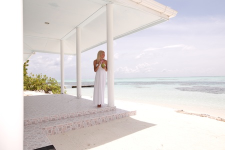 veranda: woman on the veranda of the tropical house Stock Photo