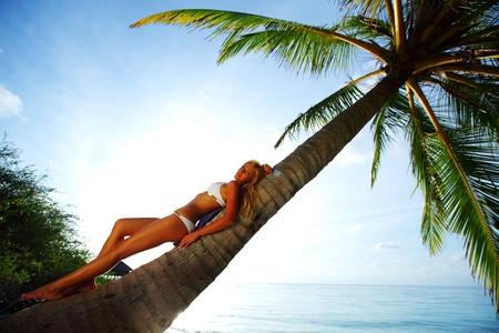 backgroud: woman on palm sea on backgroud Stock Photo