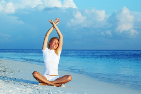 yoga woman on sea coast Stock Photo - 11975889