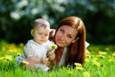Happy mother and daughter on the green grass Stock Photo - 12040819
