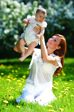Happy mother and daughter on the green grass Stock Photo - 12040808