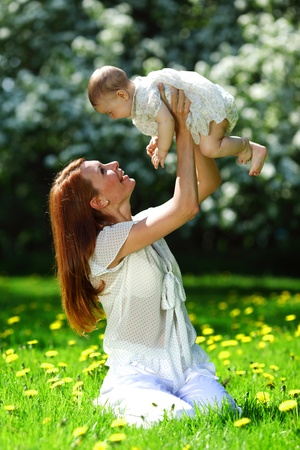 Happy mother and daughter on the green grass Stock Photo - 12040964