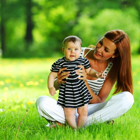 Happy mother and daughter on the green grass Stock Photo - 12040654