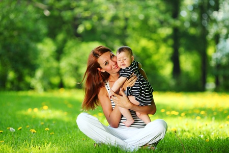 Happy mother and daughter on the green grass Stock Photo - 12041079