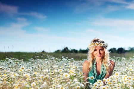 beautiful girl on the daisy flowers field Stock Photo - 12041126