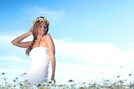 beautiful girl  in dress on the daisy flowers field  photo