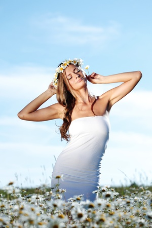 beautiful girl  in dress on the daisy flowers field  photo