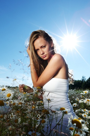 beautiful girl  in dress on the sunny daisy flowers field Stock Photo - 12041082