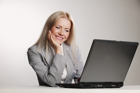 business woman working on laptop photo