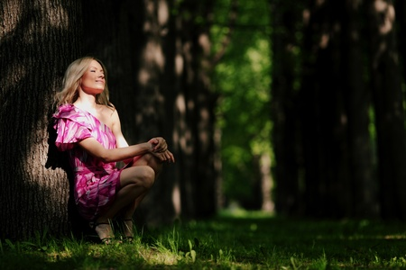 Woman sitting on a shady park alley Stock Photo - 12040733