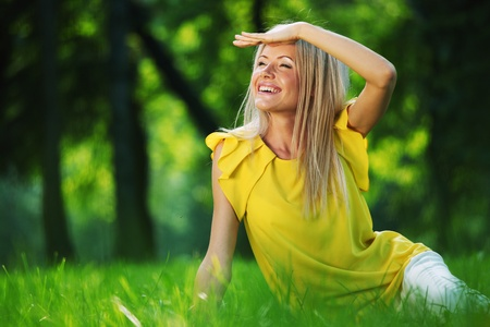 outsides: happy woman sitting on grass Stock Photo