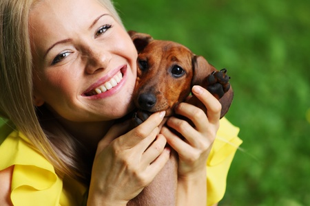woman dachshund in her arms on grass Stock Photo - 12040732