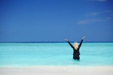business woman stay in ocean waves