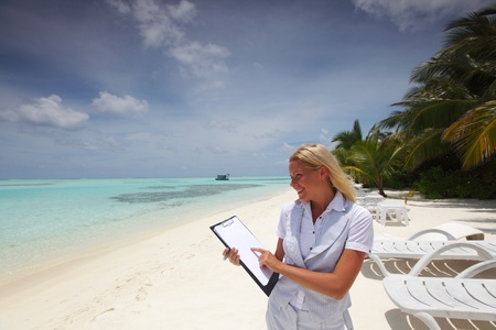 business woman with blank paper on the desolate ocean coast photo