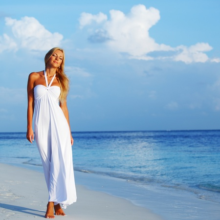 woman in a white dress on the ocean coast Stock Photo - 12079877