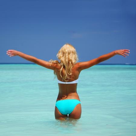 wet bikini: woman  playing in ocean water