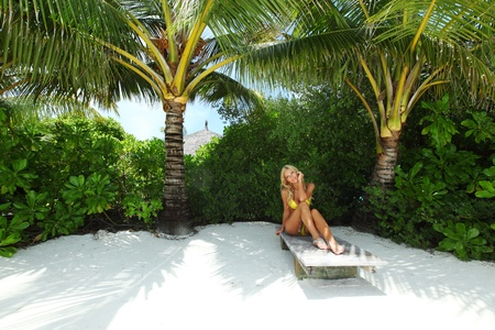 tropical woman relax on lounge Stock Photo - 12079734