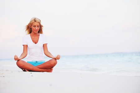 yoga woman on sea coast Stock Photo - 12079873