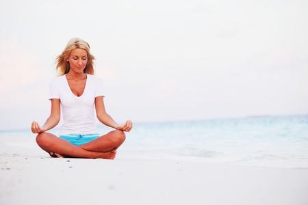 yoga woman on sea coast Stock Photo - 12079873
