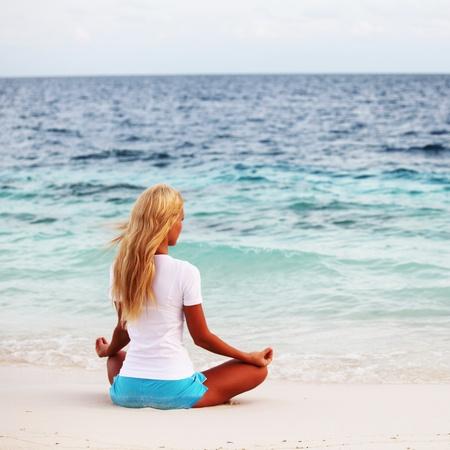 yoga woman on sea coast Stock Photo - 12079837