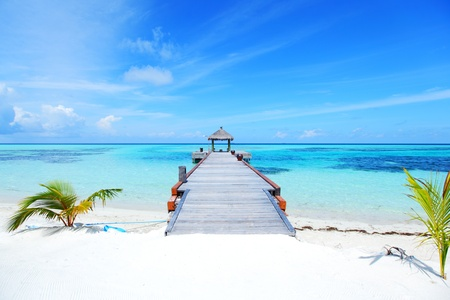 resort maldivian houses in blue sea photo