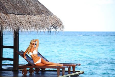 woman on lounge sea on background Stock Photo - 12079743